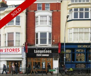 Retail over basement & ground floor. Let to LangeLees cafe at £22,500 pa. 3 floor maisonette let at £16,320 pa.