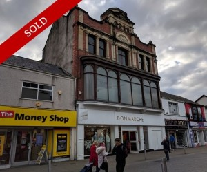 Development opportunity. Potential for 13 flats in Central High Street Location. Let to Bonmarche Properties Limited.